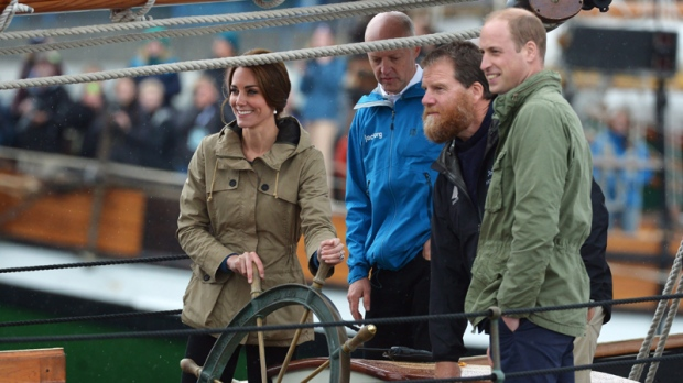 The Duke and Duchess of Cambridge steer a tallship into harbour, in Victoria on Saturday, October 1, 2016. THE CANADIAN PRESS/Jonathan Hayward