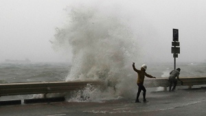 Waves crash on waterfront caused by Typhoon Haima in Hong Kong on Friday, Oct. 21, 2016. (AP / Kin Cheung)