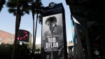 A sign outside of the Cosmopolitan of Las Vegas congratulates Bob Dylan, Thursday, Oct. 13, 2016, after he won the 2016 Nobel Prize in literature. (AP Photo/John Locher)