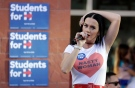Singer Katy Perry speaks at a rally in support of Democratic presidential nominee Hillary Clinton, Saturday, Oct. 22, 2016, in Las Vegas. (AP Photo/John Locher)