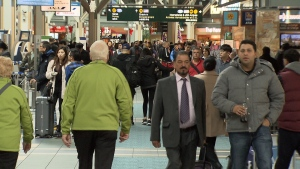 Passengers walk through Vancouver International Airport during the busy holiday season.