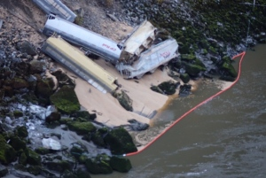 A train transporting grain derailed north of Hope, B.C. on Tuesday, plunging some of the cars into the Fraser River. (CTV)