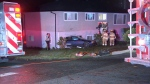 A Burnaby family was shaken but uninjured after a car involved in a dramatic shooting crashed into the lower level of their home on Oct. 26, 2016. (CTV)