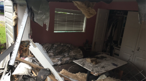 A young woman was left shaken but remarkably uninjured after a car slammed through the wall of her bedroom after a Burnaby shooting. (CTV)