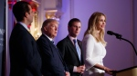 Republican presidential candidate Donald Trump, flanked by his sons, Donald Trump Jr., left, and Eric Trump, listens on as his daughter Ivanka Trump speaks during the grand opening of the Trump International Hotel-Old Post Office, Wednesday, Oct. 26, 2016, in Washington. (AP Photo/ Evan Vucci)
