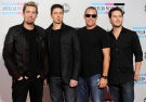 Chad Kroeger, Daniel Adair, Mike Kroeger, and Ryan Peake of the band Nickelback arrives at the 39th Annual American Music Awards on Sunday, Nov. 20, 2011 in Los Angeles. (AP Photo/Chris Pizzello)
