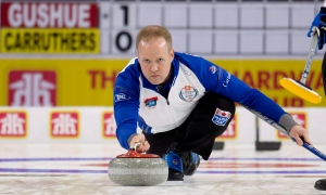 Team Gushue alternate skip Mark Nichols throws a stone during the Canada Cup of Curling final against Team Guhue in Brandon, Man., on Sunday, Dec. 4, 2016. (Michael Burns / THE CANADIAN PRESS)