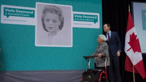 Minister of Finance William Morneau and Wanda Robson, look on as Viola Desmond is announced at the first woman featured on Canadian currency during a ceremony in Gatineau, Que. Thursday December 8, 2016. Wanda Robson, is the sister of Viola Desmond. THE CANADIAN PRESS/Adrian Wyld