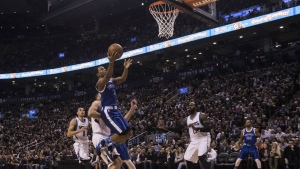 Toronto Raptors' Kyle Lowry scores against the Minnesota Timberwolves during first half NBA basketball action in Toronto on Thursday, Dec. 8, 2016. (Chris Young / THE CANADIAN PRESS)