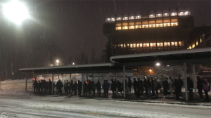 A large crowd of students continue waiting for transit hours after learning their final exams were cancelled at Simon Fraser University's Burnaby Mountain campus on Friday. Dec. 9, 2016. (CTV)