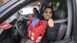 A Delta woman was surprised when police pulled her over to give her a holiday gift. (CTV)