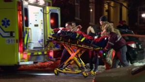 A 39-year-old stabbing victim is placed in an ambulance on Ste. Catherine St. near Viau Blvd. (CTV Montreal/Cosmo Santamaria)