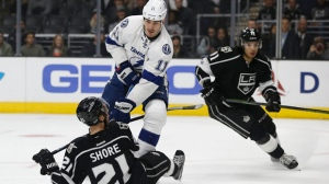 Los Angeles Kings center Nick Shore (21) falls to the ice as Tampa Bay Lightning center Brian Boyle (11) passes the puck away from Jordan Nolan (71) during the first period of an NHL hockey game in Los Angeles, Monday, Jan. 16, 2017. (AP Photo/Alex Gallardo)