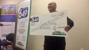 Curtis Mooney celebrates his $5-million Lotto 6-49 win in Saskatoon on Monday, Jan. 16, 2017. (Julie Clark/CTV Saskatoon)