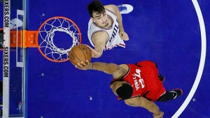 Philadelphia 76ers' Dario Saric, top, blocks a dunk by Toronto Raptors' Norman Powell during the second half of an NBA basketball game, Wednesday, Jan. 18, 2017, in Philadelphia. Philadelphia won 94-89. (AP Photo/Matt Slocum)