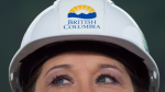 Wearing a hard hat, B.C. Premier Christy Clark listens to a question on Friday November 4, 2016. THE CANADIAN PRESS/Darryl Dyck