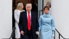President-elect Donald Trump and his wife Melania walk out together after attending church service at St. John's Episcopal Church across from the White House in Washington, Friday, Jan. 20, 2017. (Pablo Martinez Monsivais/THE ASSOCIATED PRESS)