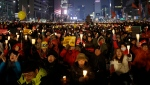 Protesters stage a candle light vigil calling for impeached President Park Geun-hye to step down in Seoul, South Korea, Saturday, Jan. 21, 2017. (AP Photo/Ahn Young-joon)