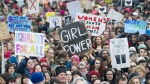 Crowds of people gather to protest the inauguration of U.S. President Donald Trump in Montreal, Saturday, January 21, 2017. Protests are being held across Canada today in support of the Women's March on Washington. Organizers say 30 events in all have been organized across Canada, including Ottawa, Toronto, Montreal and Vancouver. THE CANADIAN PRESS/Graham Hughes