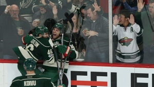 Minnesota Wild's Jason Zucker celebrates with teammate Jared Spurgeon after Zucker scored a goal against the Anaheim Ducks during the third period of an NHL hockey game Saturday, Jan. 21, 2017, in St. Paul, Minn. The Wild won 5-3. (AP Photo/Stacy Bengs)