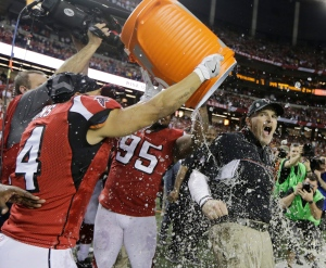 Atlanta Falcons head coach Dan Quinn reacts as he is dunked after the NFL football NFC championship game against the Green Bay Packers Sunday, Jan. 22, 2017, in Atlanta. The Falcons won 44-21 to advance to Super Bowl LI. (AP Photo/Mark Humphrey)