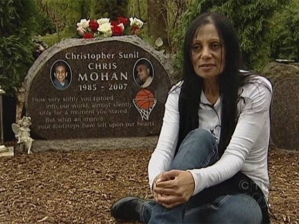 Eileen Mohan, the mother of Surrey shooting victim Chris Mohan, sits beside her son's grave. April 10, 2009.