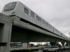 Canada Line train cars sit parked on the tracks near the Vancouver International Airport in Richmond, B.C. August 4, 2009. (THE CANADIAN PRESS/Darryl Dyck)