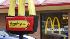 In this photo made on Wednesday, Oct. 14, 2009 a car moves the the drive through service behind the trademark golden arches of a McDonald's restaurant in Pittsburgh. (AP Photo/Keith Srakocic)