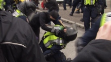 Vancouver police crowd control unit officer and an anti-Olympic protester clash in downtown Vancouver after anti-Olympic protesters rampage through downtown Vancouver, damaging businesses and vehicles on Saturday, Feb. 13, 2010 (CTV)