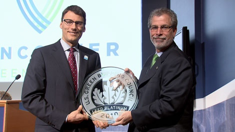 Tim Cole of the U.S. Green Building Council presents Vancouver Mayor Gregor Robertson with the LEED Platinum award for the False Creek South neighbourhood. Feb. 16, 2010.