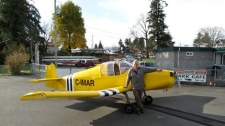 A small plane crash victim on Vancouver Island was identified Wednesday as Bert Smit of Courtenay, B.C. He is pictured next to his two-seater Jodel aircraft, which he built himself. March 3, 2010. (Courtenay Airpark website)