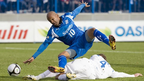 Montreal Impact's Roberto Brown, (10) is fouled by Shaun Pejic of the Vancouver Whitecaps' during the first half of the USL First Division championship final in Montreal, Saturday, October 17, 2009. THE CANADIAN PRESS/Graham Hughes