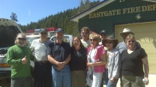 Dean Russell, third from left, meets members of the East Gate Fire Department after finding the department's stolen truck. May 13, 2010. (CTV)