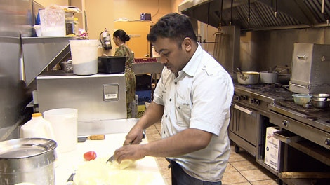 A cook slices and dices at the Mayuri restaurant in Surrey, B.C., which has been the target of phony health inspectors. June 7, 2010. (CTV)