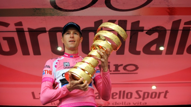 Canada's Ryder Hesjedal holds the trophy after winning the 95th Giro d'Italia, Tour of Italy cycling race, in Milan, Italy, Sunday, May 27, 2012. (AP / Fabio Ferrari)