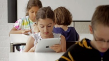 A student uses an iPad tablet in class in this file image. (CTV)
