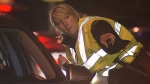 A police officer is conducting a drunk-driving roadblock in this file photo. (CTV)