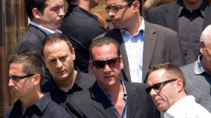 Leonardo Rizzuto, right, son of jailed Mafia 'godfather' Vito Rizzuto, leaves the church after funeral services for reputed organized crime leader Agostino Cuntrera in Montreal, Monday, July 5, 2010. (Ryan Remiorz / THE CANADIAN PRESS)