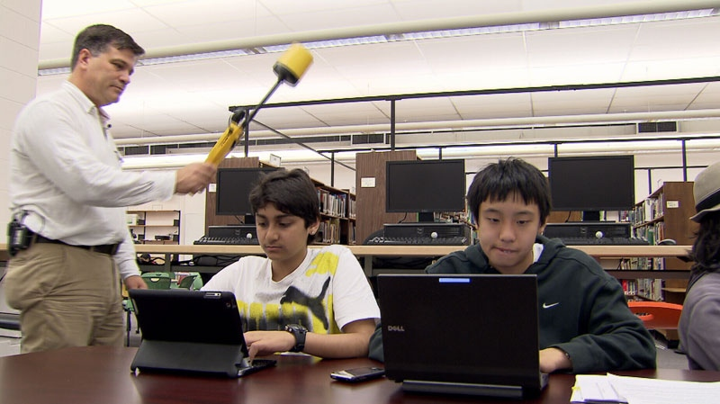 Karl Reardon tests the electromagnetic emissions from Wi-Fi devices in a Vancouver school. June 27, 2012. (CTV)