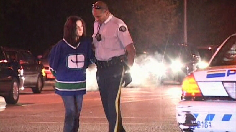 An alleged drunk driver is arrested by police after the crash that killed 22-year-old Kassandra Kaulius on May 3, 2011. (CTV)