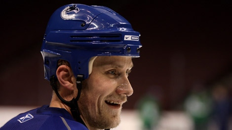 Vancouver Canucks' Sami Salo, of Finland, looks on during team practice in Vancouver, B.C., on Friday May 1, 2009. The Canucks and Chicago Blackhawks play game 2 of their NHL Western Conference semi-final playoff series Saturday in Vancouver. THE CANADIAN PRESS/Darryl Dyck