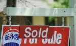 """A house """"sold"""" sign is shown in Oakville, Ont., Monday, July 23, 2012. (Richard Buchan / THE CANADIAN PRESS)"""