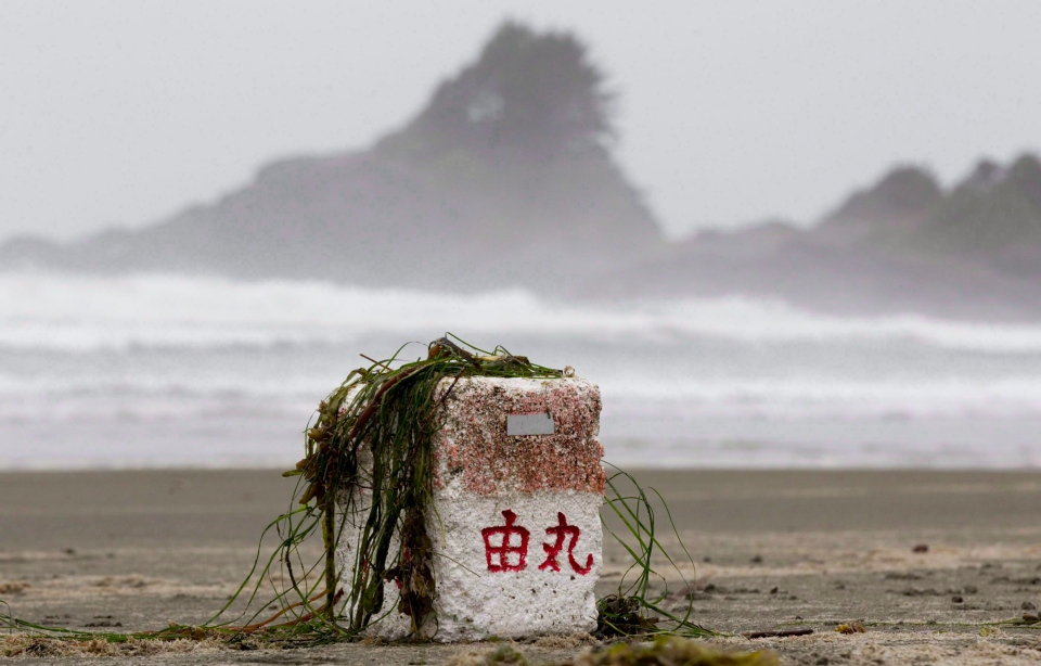 Ocean debris believed to be from Japan is posed for a photograph on Long Beach in Tofino, B.C., April, 18, 2012. THE CANADIAN PRESS/Jonathan Hayward