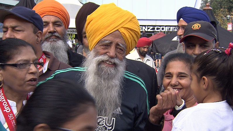 Fauja Singh is congratulated by friends and family at the inaugural Surrey International Music Marathon on Sunday Sept. 30, 2012. (CTV)